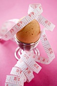 Egg in an Egg Cup with Measuring Tape