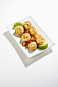 Lime Grilled Scallops on White Dish; White Background
