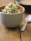 Bowl of Cole Slaw on Wooden Table