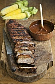 Sliced Barbecue Ribs on Cutting Board with Sauce