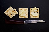 Saltine Crackers with Butter; Knife