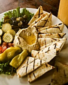 Hummus Platter with Grilled Pita Bread, Pickles and Olives
