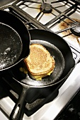 Grilled Cheese Sandwich in Pan on Stove
