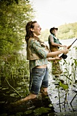 Daughter and Father Fly Fishing in the River