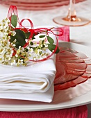 Place Setting with Pink Plates and Spring Flowers