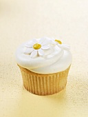 Vanilla Cupcake Frosted with Candy Daisies