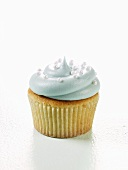 Vanilla Cupcake Decorated with Blue Frosting and Candy Pearls
