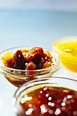 Three Bowls of Assorted Fruit Preserves