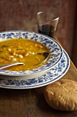 Bowl of Corn Soup with Wine and Bread