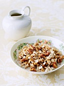 Bowl of Oatmeal with Walnuts and Maple Syrup