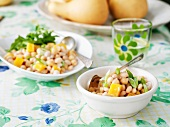 Vegetarian Bean Salad in Individual Bowl and Serving Bowl on Table