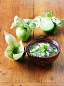 Small Bowl of Salsa Verde with Fresh Tomatillos