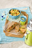Veggie Sandwich with Melon Salad on Blanket at Beach