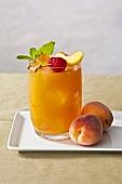 Peach Cocktail with Raspberry Peach Garnish