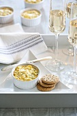 Hot Clam Dip with Crackers and Glasses of White Wine