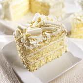 Slice of White Layer Cake with White Chocolate Curls