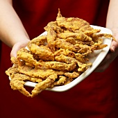 Person Holding Platter of Fried Soft Shell Crabs