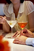 Couple with Cocktails; Martini and Manhattan
