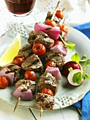 Three Grilled Lamb Kabobs on a Plate