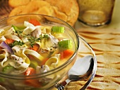 Chicken Noodle Soup in a Glass Bowl