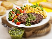 Grilled Rib Eye Steak with Herb Sauce, Fries and Veggies