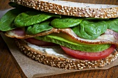 Bacon, Spinach, Tomato and Avocado Sandwich on Whole Wheat Bread