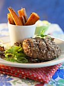 Grilled Hamburger on Greens with Sweet Potato Fries