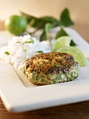 Salmon Cake with Lime Wedges and Rice