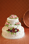 White Wedding Cake Decorated with Frosting Roses
