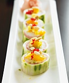 Cucumber Sushi Roll Topped with Clementine and Pine Nuts