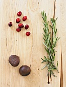 Chestnuts, Cranberries and Rosemary on Wood