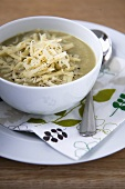 Bowl of Brussels Sprout Soup with Shredded Cheese