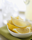 Lemon Wedges in a Small Dish on Green Napkin