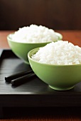 Two Bowls of White Rice with Chopsticks