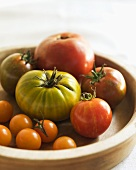 Organic Heirloom Tomatoes in a Wooden Bowl