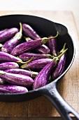 Organic Asian Eggplants in Cast Iron Skillet