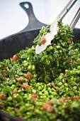 Sauteed Peas, Greens and Chorizo; Tongs