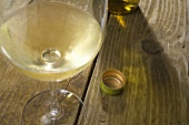 Glass of White Wine on a Rustic Wooden Table