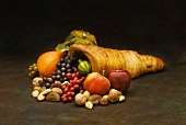 Horn of plenty with fruit, nuts and squashes