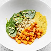 Sauteed Spinach, Sweet Potato, Pine Nuts, Raisins, Brown Rice and Socca Bread