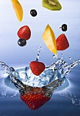 Mixed Fruit Splashing into Water