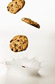 Chocolate Chip Cookies Splashing into Milk