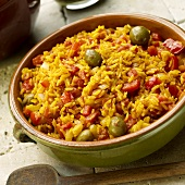 Spanish Rice with Green Olives, Red Peppers and Tomatoes in Earthenware Bowl