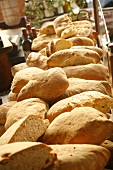 Many Loaves of Bread Piled at Market; Florence, Italy
