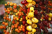 Orange, Red and Yellow Peppers with Dried Peppers at Market; Florence Italy