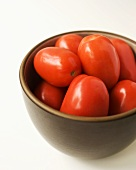 Organic Roma Tomatoes in a Brown Bowl