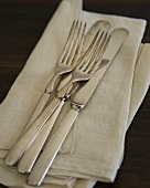 Tarnished Antique Silverware on Linen Napkin