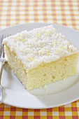 Piece of Lemon Buttermilk Sheet Cake on a White Dish