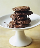 Stacked Chocolate Cookies on White Pedestal Dish