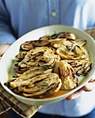 Person Holding Platter of Grilled Fennel